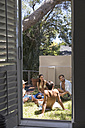 Group of friends relaxing in garden at the poolside - WESTF23219