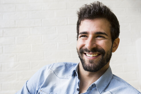 Portrait of laughing young man with beard - ABZF02044