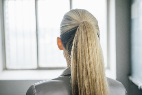 Back view of blond woman with ponytail - JOSF01072