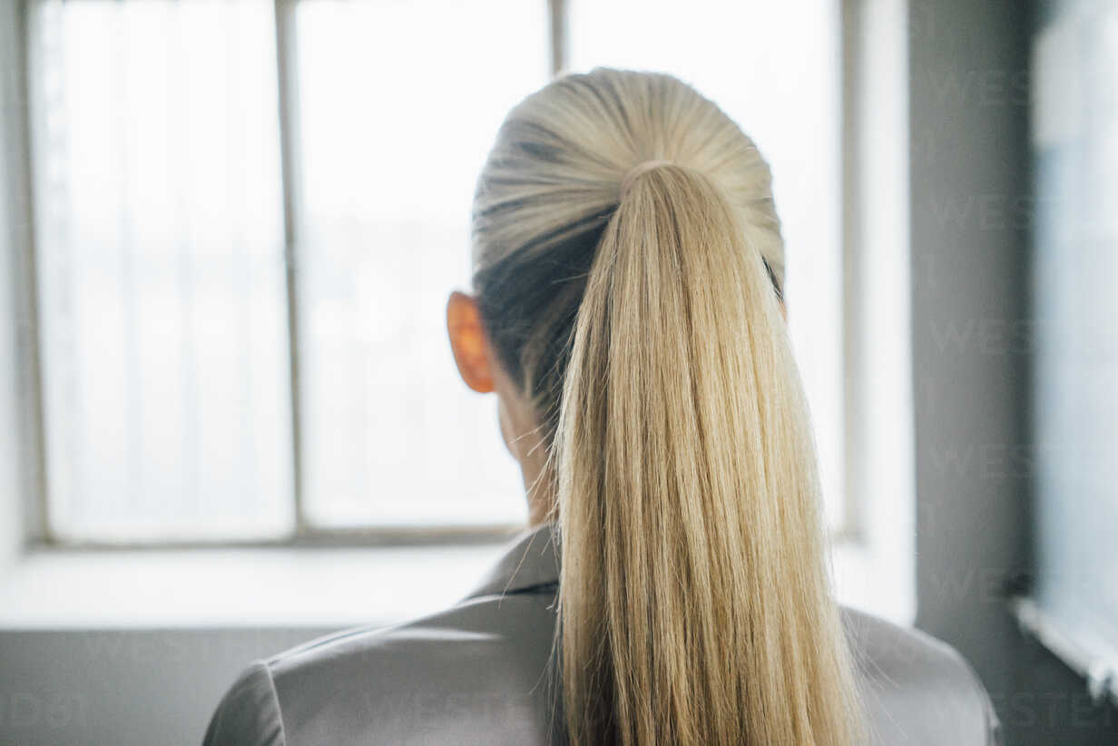 Back view of blond woman with ponytail - JOSF01072 - Joseffson/Westend61