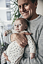 Smiling father holding baby - MFF03599