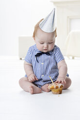 Baby boy testing birthday cake - FSF00923