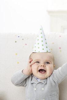 Portrait of baby boy wearing paper hat - FSF00929