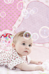Portrait of baby girl watching soap bubbles - FSF00938