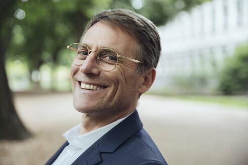 Portrait of smiling mature businessman outdoors - MFF03615