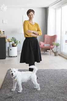 Portrait of woman and her dog in the living room - RBF05713