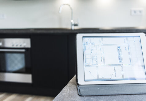 Tablet with floor plan on kitchen counter - UUF10832