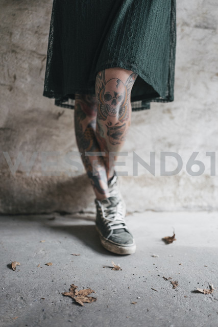 Legs of a young woman with tattoos - JOSF01120
