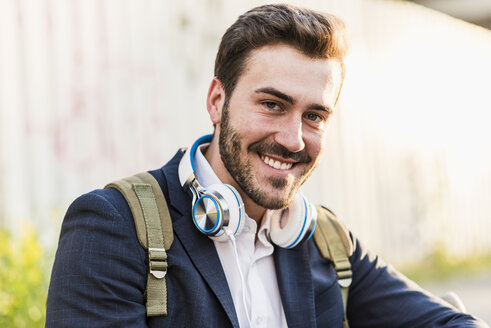 Portrait of smiling young man outdoors - UUF10840