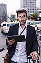 Young man in the city with tablet - UUF10855