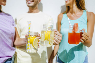 Close-up of friends holding refreshing drinks - KIJF01522