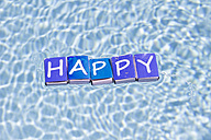 Letters on match boxes building the word 'Happy' floating on water - CMF00683