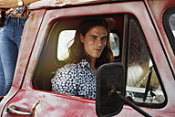Portrait of young man in an old pick up - ZEF13880