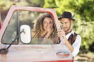 Happy young couple at old pick up truck - ZEF13889