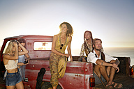 Happy young people outside pick up truck at the coast - ZEF13913