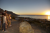 Young people outside pick up truck at the coast enjoying the sunset - ZEF13919