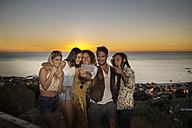 Young people taking a selfie at the coast the sunset - ZEF13922