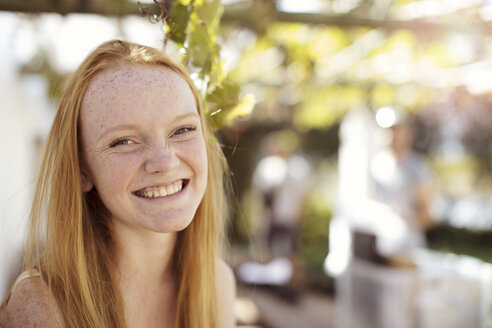 Portrait of happy girl with long red hair - ZEF13924