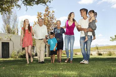 Happy extended family in garden - ZEF13942