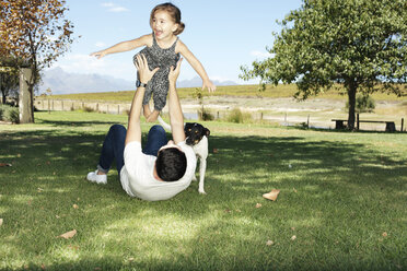 Father playing with daughter in garden - ZEF13948