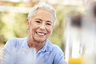 Portrait of smiling senior woman outdoors - ZEF13957