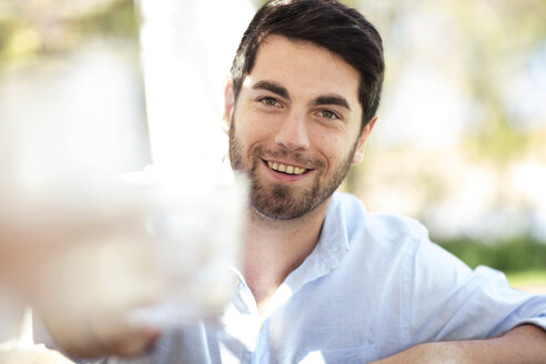 Portrait of smiling young man outdoors - ZEF13960