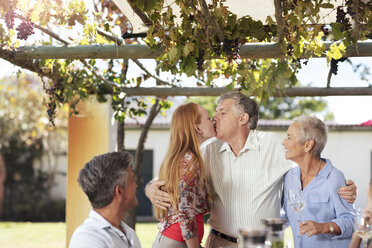 Happy senior couple with family having lunch together outside - ZEF13975