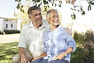 Happy senior couple in garden - ZEF13990