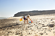 Spain, Fuerteventura, girl playing on the beach - MFRF00866