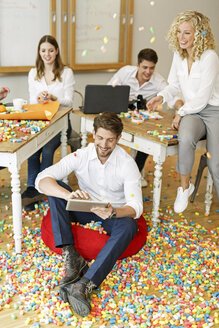 Creative professionals meeting in office surrounded by colorful polystyrene parts - PESF00635