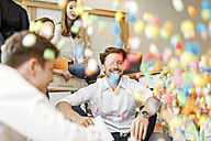 Playful creative professionals meeting in office - PESF00638