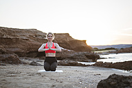 Greece, Crete, woman practicing yoga on the beach - CHPF00403