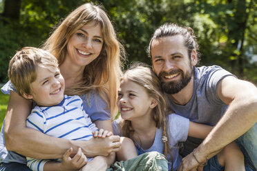 Portrait of happy family outdoors - TCF05440
