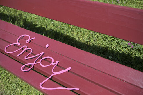 Word enjoy on a bench - PSTF00036
