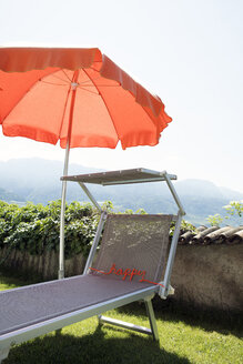 Word happy on sun lounger - PSTF00039