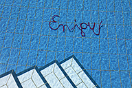 Word enjoy in water of a swimming pool - PSTF00042