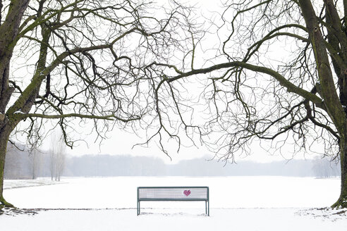 Embroidered heart at bench in winter landscape - PSTF00045
