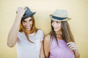 Portrait of two smiling women wearing hats - KIJF01603