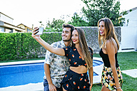 Friends taking a selfie at the poolside - KIJF01630