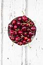 Bowl of cherries on white wood - LVF06156