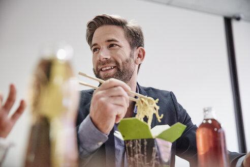 Businessman having lunch break with asian food - RHF01975