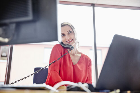 Woman on the phone in office - RHF01984