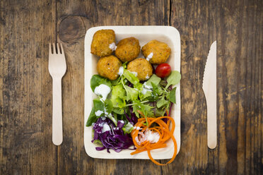 Falafel and salad on wooden disposable plates and cutlery - LVF06165