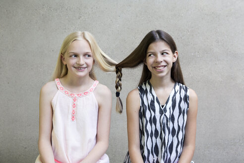 Portrait of two long-haired girls with one braid - PSTF00054
