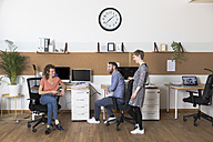 Smiling colleagues in modern office - FKF02368