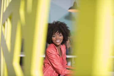 Portrait of smiling woman in office lounge - ZEF14021