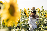 Woman in a sunflower field - MAUF01072