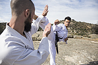 Man doing a high kick during a martial arts combat - ABZF02111
