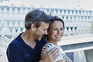 Portrait of happy mature couple outdoors - RORF00963