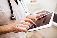 Close-up of vet using tablet in clinic - HAPF01703